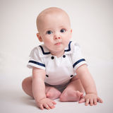 Baby Boy Sitting On Floor In Sailor Suit Stock Photos