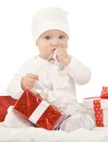 Baby boy sitting  with gift Royalty Free Stock Photography