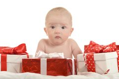Baby boy sitting  with gifts Royalty Free Stock Image