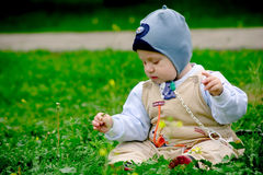 Baby boy sitting on grass. Baby boy sitting in green grass in spring stock image