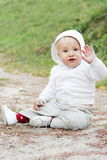 Baby Boy Sitting on the Ground Stock Images