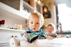 Baby boy sitting in highchair at Christmas time. Stock Photo
