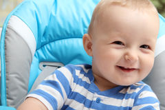 Baby boy sitting in highchair Royalty Free Stock Photos