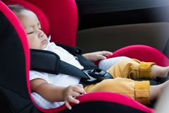 Free Baby Boy Sitting In A Car Seat . Royalty Free Stock Images - 121909189