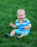 Baby boy sitting on meadow Royalty Free Stock Images