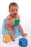 Baby boy sitting on potty Stock Photo