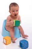 Baby boy sitting on potty Stock Photo