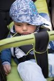 Baby boy sitting in the pram. Little and very beautiful baby boy sitting in the pram and waiting for mom Royalty Free Stock Photography