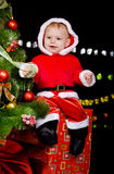 Baby boy sitting on the present box Royalty Free Stock Photo