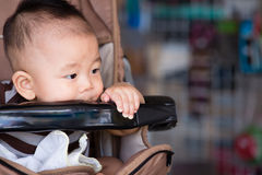 Baby boy sitting stroller stock photos