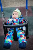 Baby boy sitting in a swing Royalty Free Stock Images