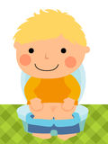 Baby boy sitting on the toilet Royalty Free Stock Images