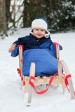 Baby boy on a sledge Stock Photo