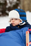 Baby boy on a sledge Royalty Free Stock Images