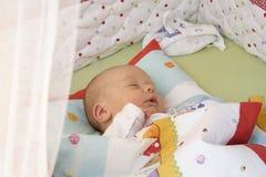 Baby boy sleeping. A sleeping baby boy in his crib Stock Photography