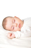 Baby boy sleeping. Peacefully on a white sheet Stock Photo