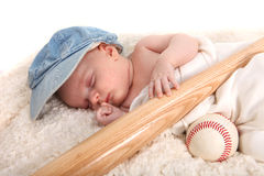 Baby Boy Sleeping With a Baseball Bat and Ball Stock Photos