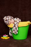 Baby boy sleeping in a basket Royalty Free Stock Images