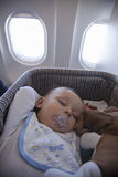 Baby Boy Sleeping In Bassinet On Airplane Stock Image