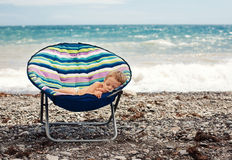 Baby boy sleeping on the beach Royalty Free Stock Photos