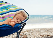 Baby boy sleeping on the beach Royalty Free Stock Photo