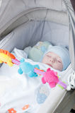 Baby boy sleeping in carriage Royalty Free Stock Images