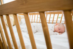 Baby boy sleeping on a cradle Stock Images