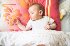 Baby boy sleeping on his back. Very calm and peaceful royalty free stock photo