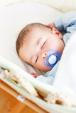 Baby boy sleeping in his cradle Stock Photos