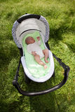 Baby boy sleeping in the pram outdoors. View from above Royalty Free Stock Photos