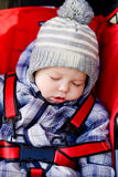 Baby boy sleeping in the stroller Stock Photo