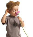Baby Boy Smelling Pretty Flower royalty free stock images