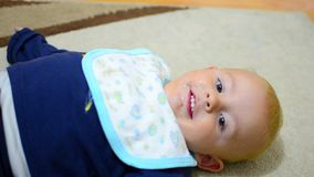Baby boy smiling and doing exercise stock video footage