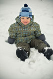 Baby boy and snow Stock Photography
