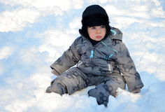 Baby boy in snow Stock Image