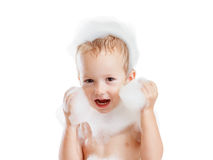 Baby boy with soap foam or shampoo Stock Images