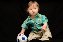 Baby boy with soccer ball. Baby boy holding a mini soccer ball Royalty Free Stock Photo