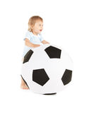 Baby boy with soccer ball Stock Photo