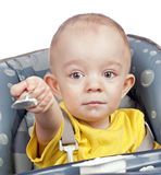Baby boy with spoon Stock Image