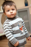 Baby boy stand. Pose, wearing a beaver knitted sweater Royalty Free Stock Photo
