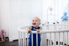 Baby boy standing in bed Royalty Free Stock Images