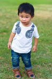 Baby boy standing on the grass. Asian little baby boy standing on the grass Stock Photography