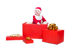 Baby boy standing in a huge Christmas gift box Stock Image