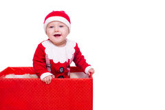 Baby boy standing in a huge Christmas gift box Stock Photo