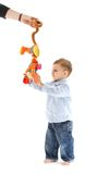 Baby boy standing with toy Royalty Free Stock Image