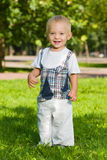 Baby boy stands in the summer park Royalty Free Stock Images