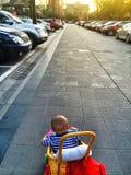 Baby boy in street. Seven month old baby boy in stroller on street Stock Photos