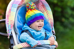 Baby boy in stroller in autumn park Royalty Free Stock Photo