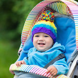 Baby boy in stroller in autumn park Royalty Free Stock Image