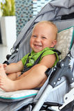 Baby boy in a stroller Stock Photography